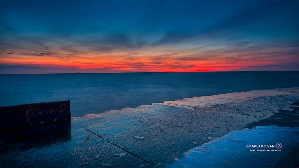 Blue Water - Red Sunrise at Montrose and Lake Michigan Chicago